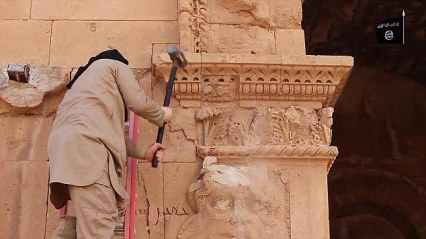 28B3FC5400000578-3089240-An_Isis_thug_destroys_a_priceless_decorative_wall_in_Hatra-a-31_1432209748072